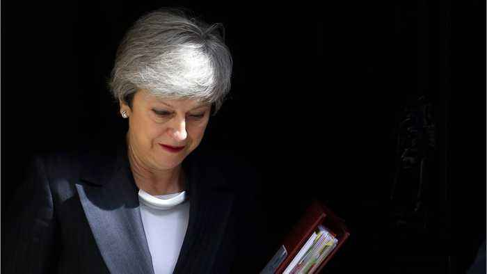 British PM May clings to power after failed fourth Brexit attempt