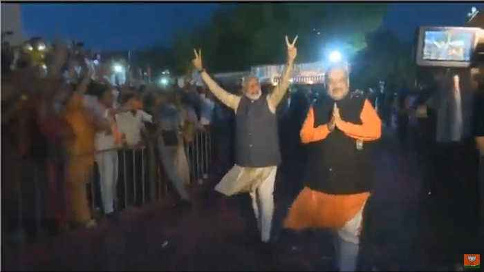 Narendra Modi shows victory sign at BJP HQ after storming back to power