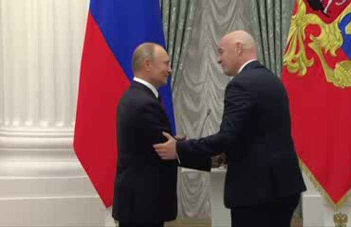 Putin honours FIFA's Infantino with state medal for 2018 World Cup