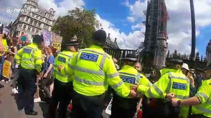Young climate activists seen shouting at police officers, London UK