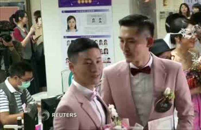 First of Taiwan's same-sex couples get married after legalisation
