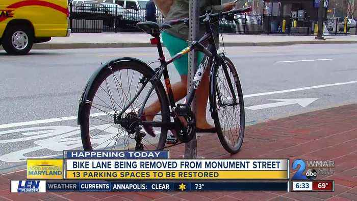 After a debate between drivers and cyclists, the city plans to remove the E. Monument St bike lanes