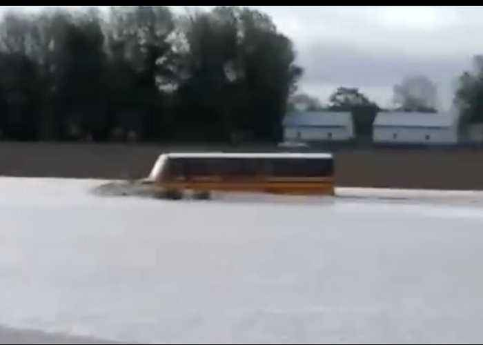 School Bus Drives Through Deep Floodwaters in West Illinois