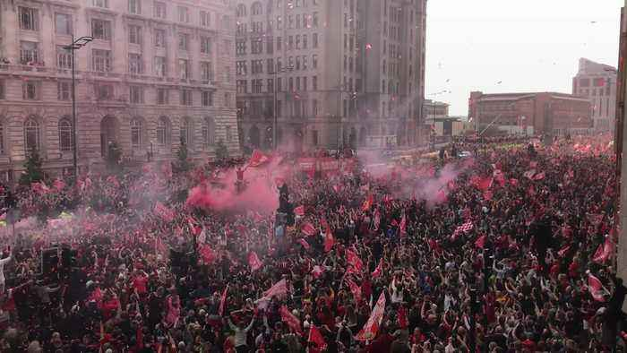 Liverpool victory bus greets thousands of fans in city centre