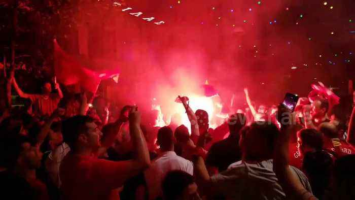 Liverpool fans in Greece celebrate wildly after Champions League