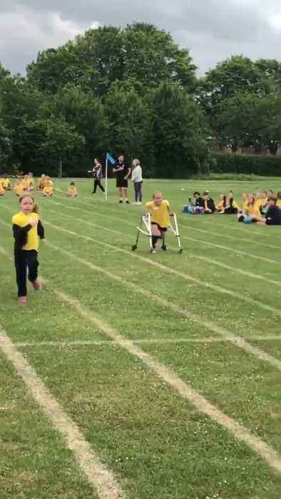 Disabled Girl Runs with Walker During Race