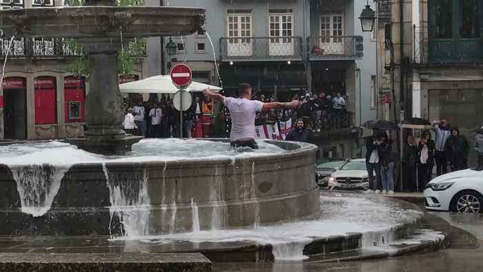 England fan jumps into fountain ahead of Nations League semi-final