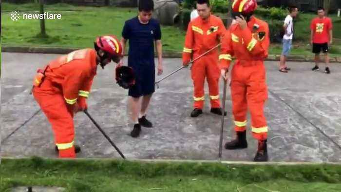 Firefighters break drain cover to get ID card back for student in China