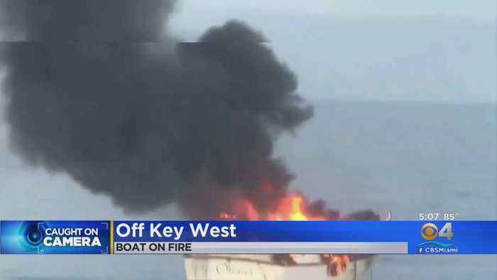 Couple, Dogs Rescued From Burning Boat