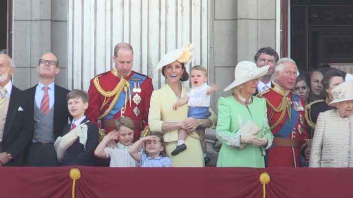 Prince Louis waves to the crowd after Trooping the Colour