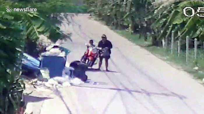 Shocking moment Thai mother dumps newborn baby in dustbin then rides away on moped