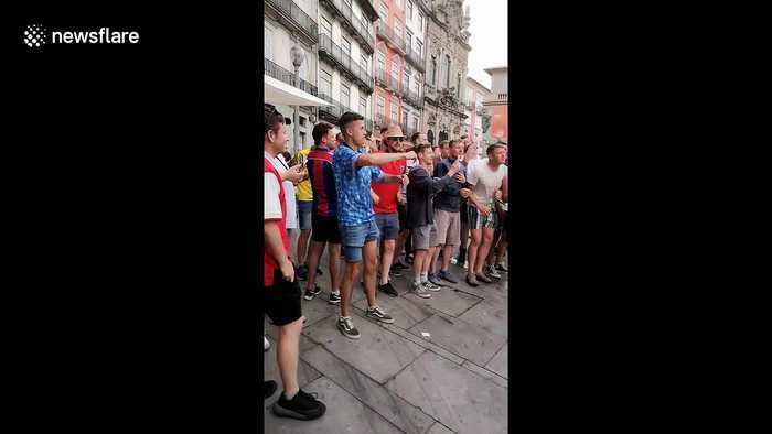 England fans sing with busker in Porto and receive guard of honour from locals