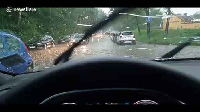 'It sounded like bullets were hitting my car!' Severe hail leaves windscreens cracked and drivers stranded in Munich