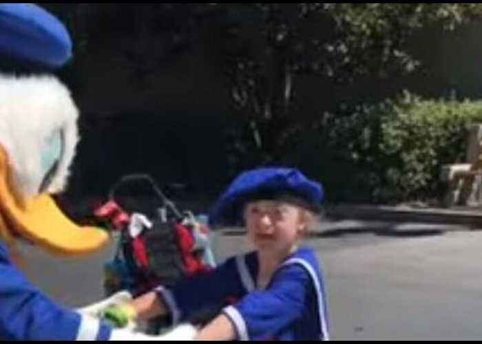 Donald Duck Shares Tender Moment With Boy With Down Syndrome
