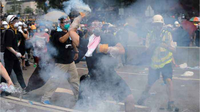 Hong Kong Police Fire Pepper Spray At Protesters