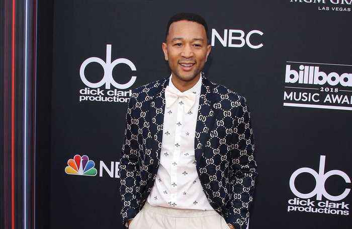 John Legend wants more dads to tackle diaper duty