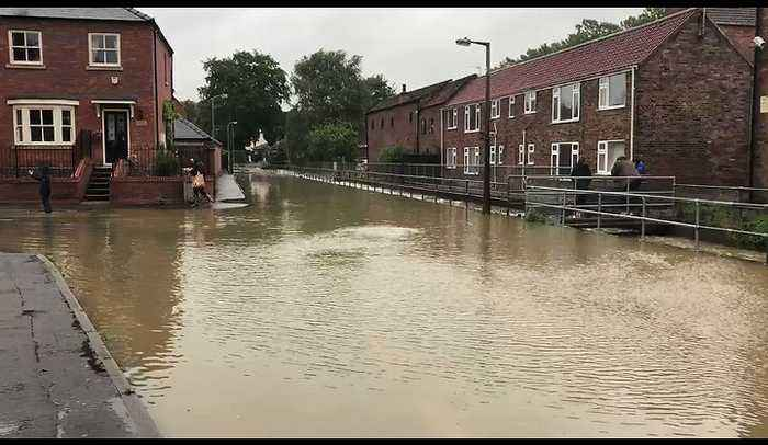 Water Cascades Down Streets of English Town After Month's Worth of Rain Falls in a Day