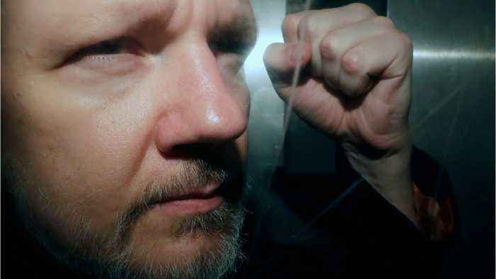 UK signs US extradition papers for Assange