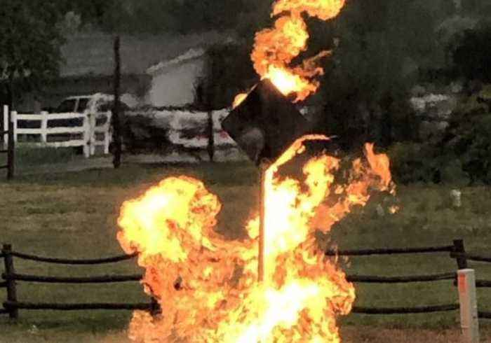 Road Sign Catches Fire After Lightning Strikes Nearby Gas Line