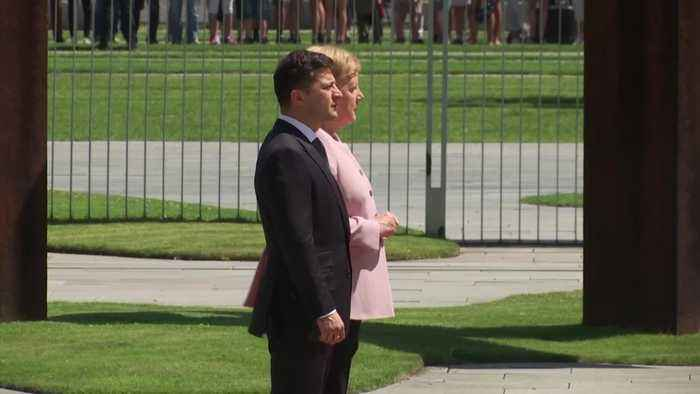 Merkel visibly shakes during ceremony with Ukrainian counterpart