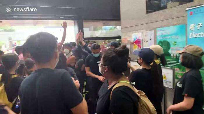 Old man quarrels with protesters inside Hong Kong's Immigration Tower