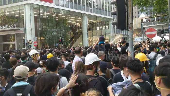 Hong Kong protesters cheer as they part ways for ambulance