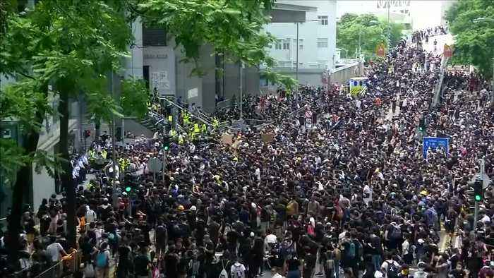 Protesters demand HK government drop charges