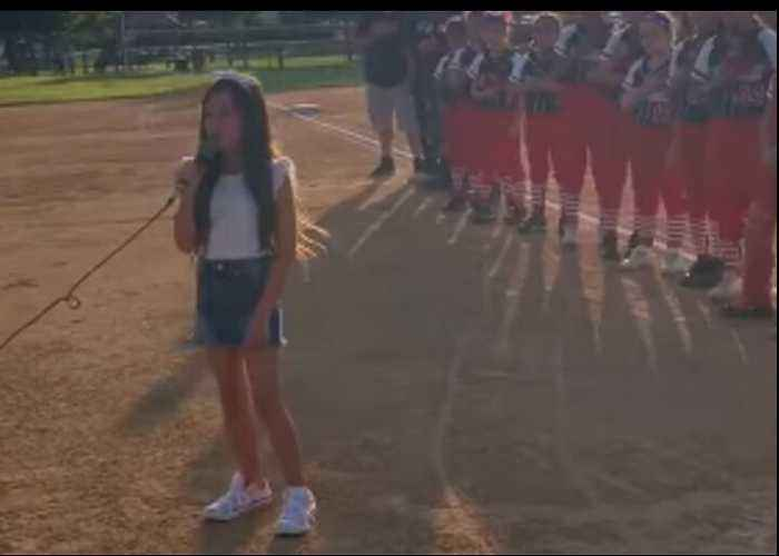 Young Girl Wows Crowd With Rendition of National Anthem at California Softball Game