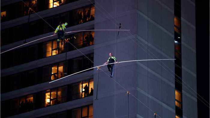Flying Wallendas Cross Times Square On A Wire