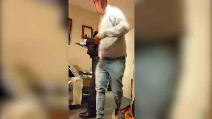 Wanted man falls through the ceiling