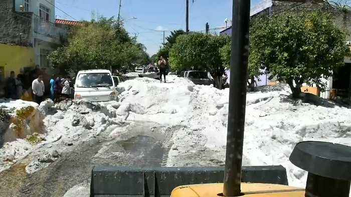Bulldozer Clears Ice From Street After Freak Storm in Mexico's Guadalajara