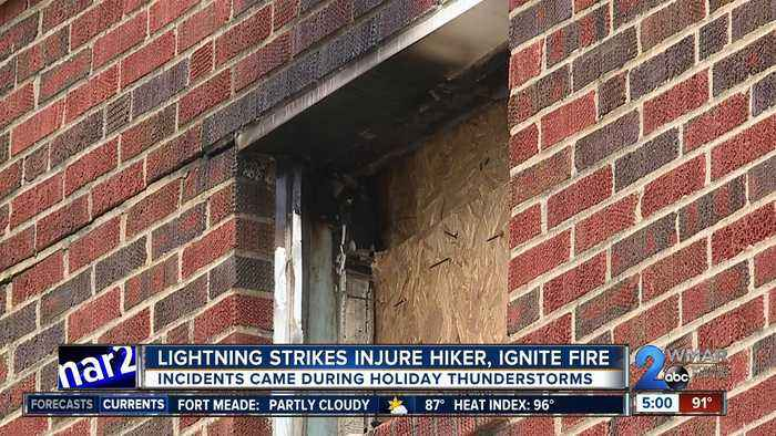 Lightning strikes injure man, ignite fire