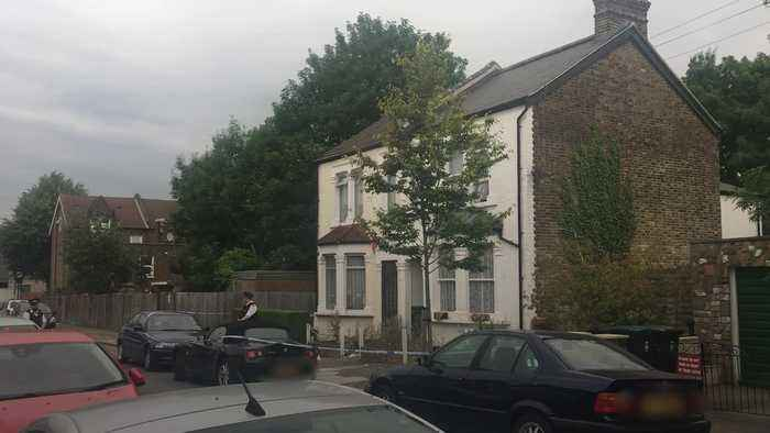 Woman and three children stabbed in north London