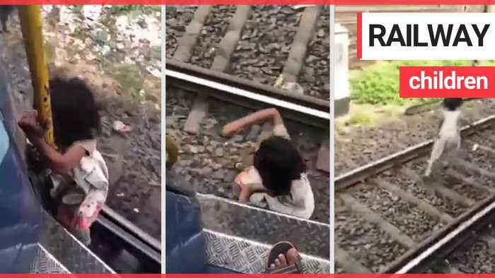 Horrified commuter films four-year-old girl clinging onto outside of moving train