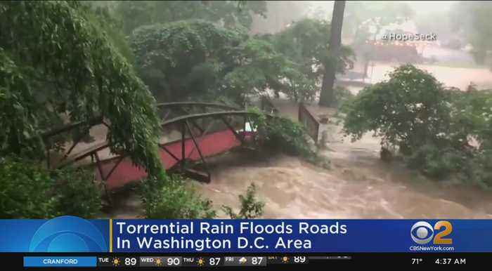 Torrential Rain Floods Roads In Washington D.C. Area