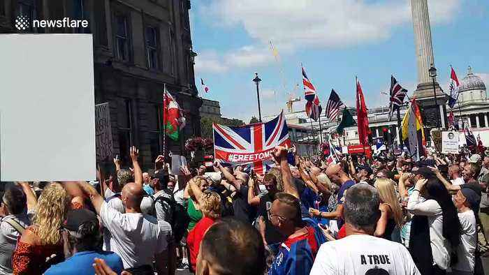 Tommy Robinson supporters gather near Trafalgar Square in support of the former EDL leader
