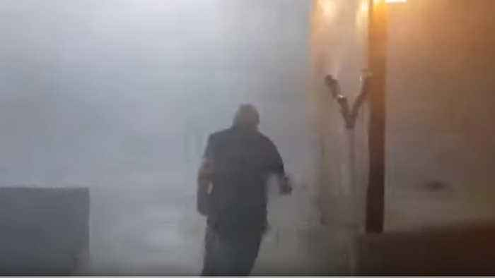 Man Dashes Through Ferocious Wind and Rain as Deadly Storm Hits Greece