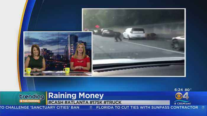 TRENDING: Drivers Pull Over For 'Cash Grab' With Money Flying Across Busy Highway