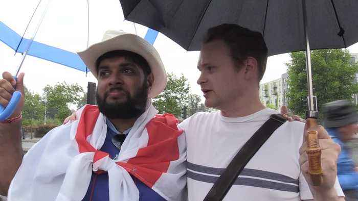 England cricket fans react after they reach the World Cup final