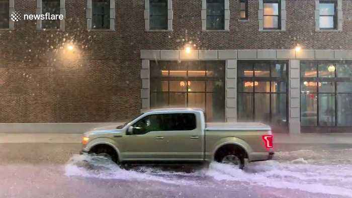 Cars power through flooded New Orleans road as Storm Barry hits