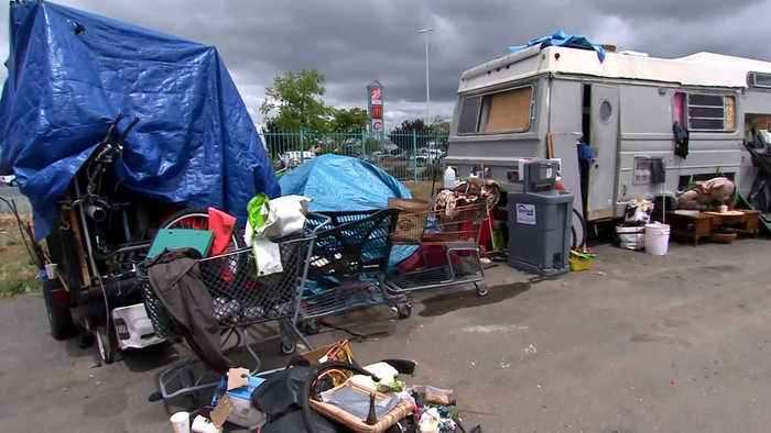 Oakland Struggles to Clean Up Homeless Camp by Home Depot