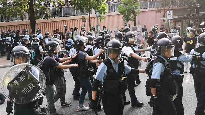 Police Intervene as Protesters Demonstrate Against Parallel Trading in Hong Kong