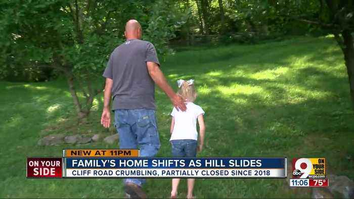 Family's Miami Township home shifts as hill slides