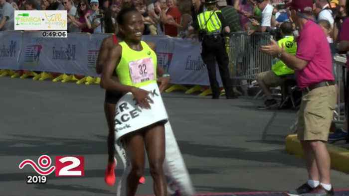 Long-distance runner, Caroline Rotich, wins women's division of Boilermaker Road Race
