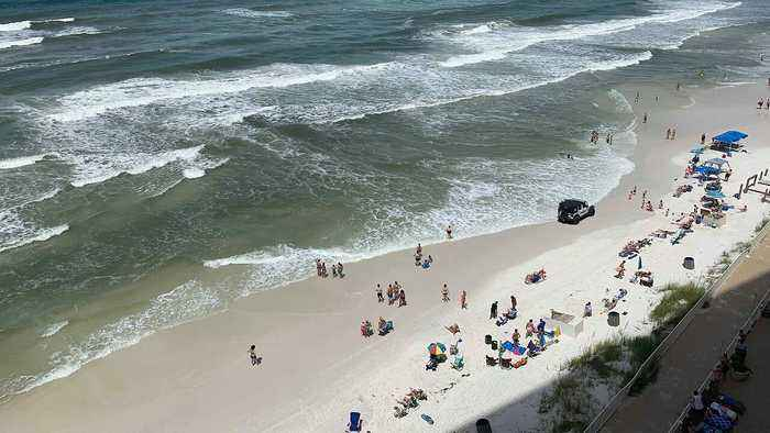 Beachgoers Form Human Chain to Help Swimmers Caught in Rip Current at Florida Beach