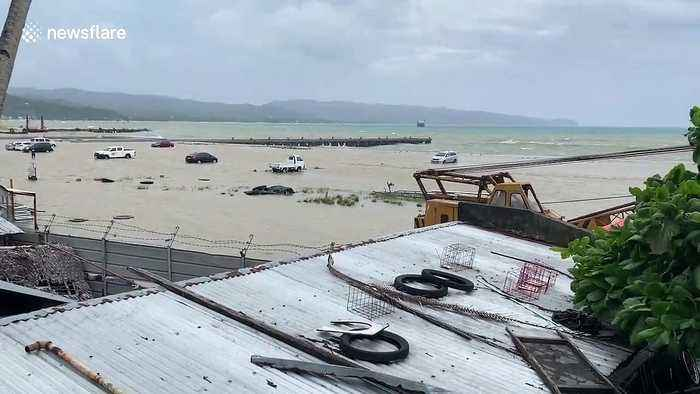 Dozens of tourists' cars stranded on beach flooded by Storm Danas in the Philippines