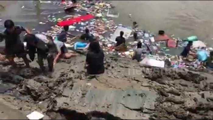 Two confirmed dead after building collapsed into river on first day of Buddhist Lent