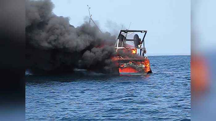Footage shows a huge fire that sunk a fishing boat