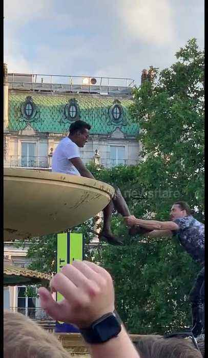 Man dubbed 'Zlatan' fails to pull celebrating cricket fan from atop London fountain and takes swim instead