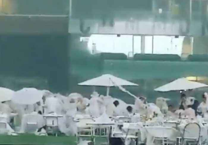 Thunderstorms Dampen Formal 'Diner en Blanc' Picnic in Edmonton